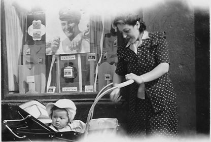 Di Duca Family. Taken in Low Patrick St. Nellie Chicky's shop front. Rose Allan with Anne 1949